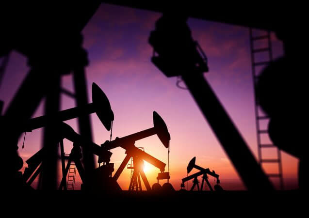 Shale Revolution: Oil Pumps at Dusk. Oil pumps producing oil at dusk.