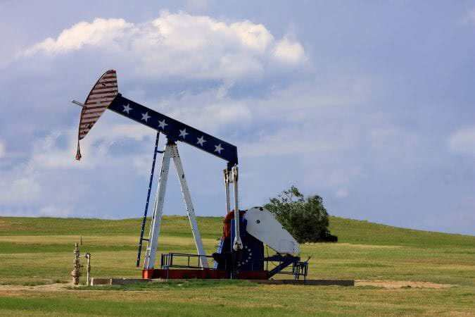 Patriotic Oil Rig - Oil Pump Jack with American Flag painted on it