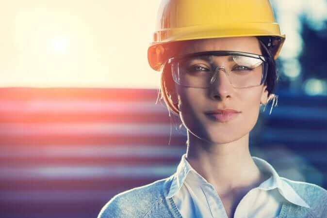 beautiful woman civil engineer close up portrait in front of a sunset background